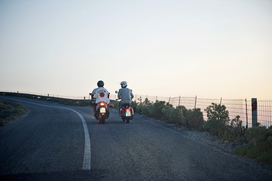 bride and groom ride a bike in amorgos wedding