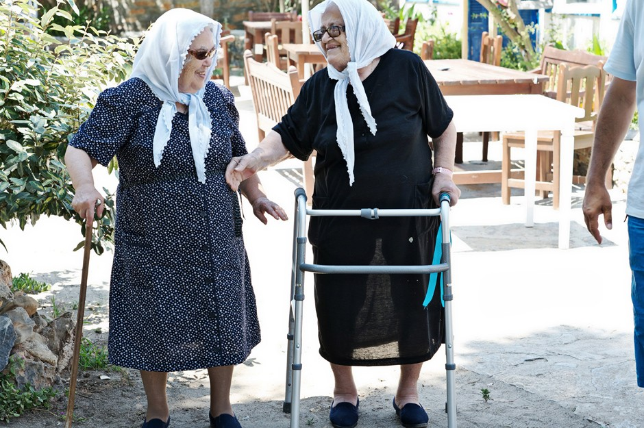 two grandmothers discussing about the wedding in amorgos