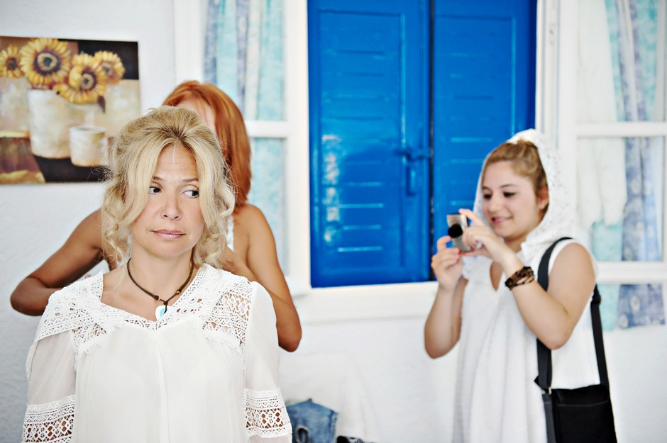 bride with bridesmaids in amorgos wedding