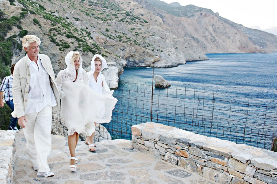 couple walking together after the wedding ceremony in amorgos