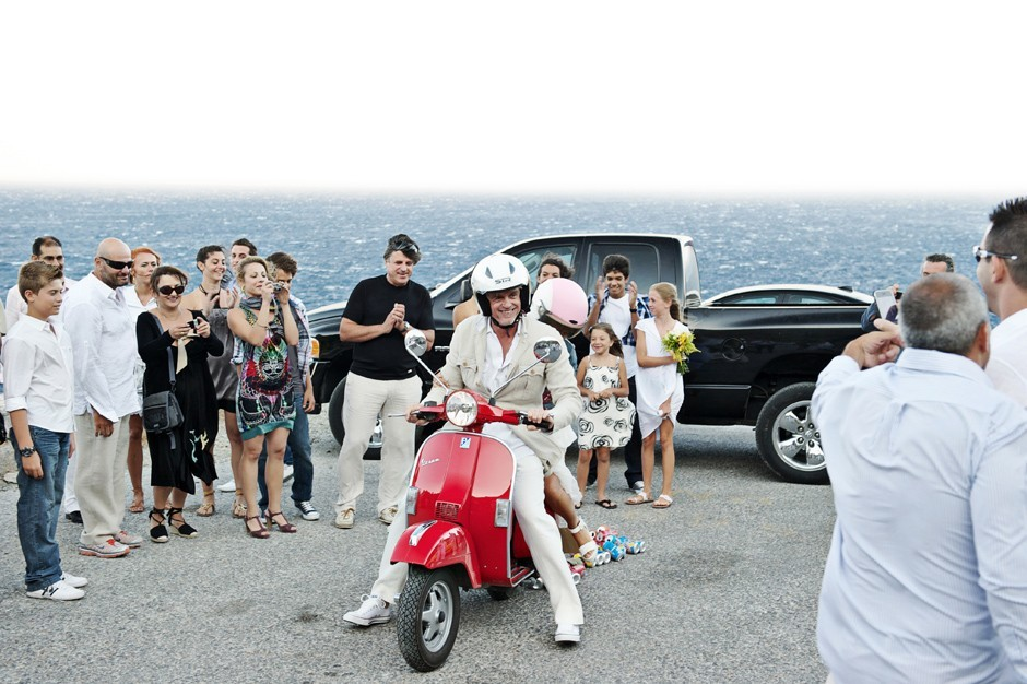 couple on a red vespa amorgos wedding