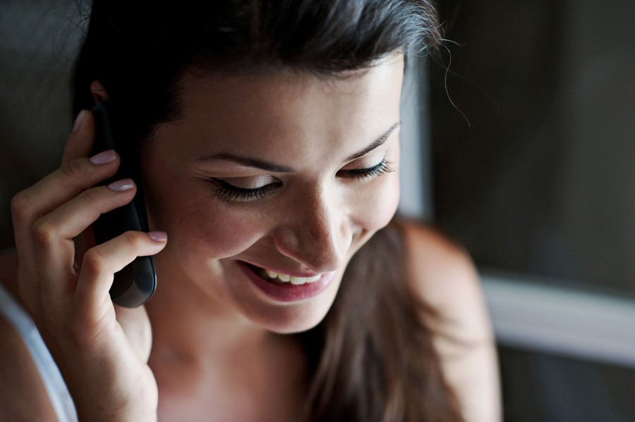 bride speaking on the phone with groom before the wedding in mykonos