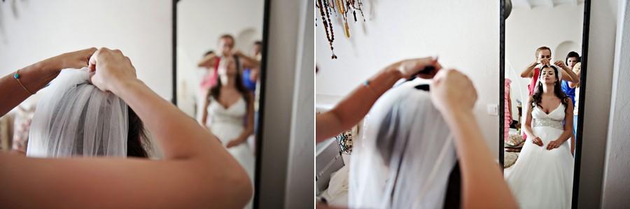 bride wearing the wedding veil in mykonos