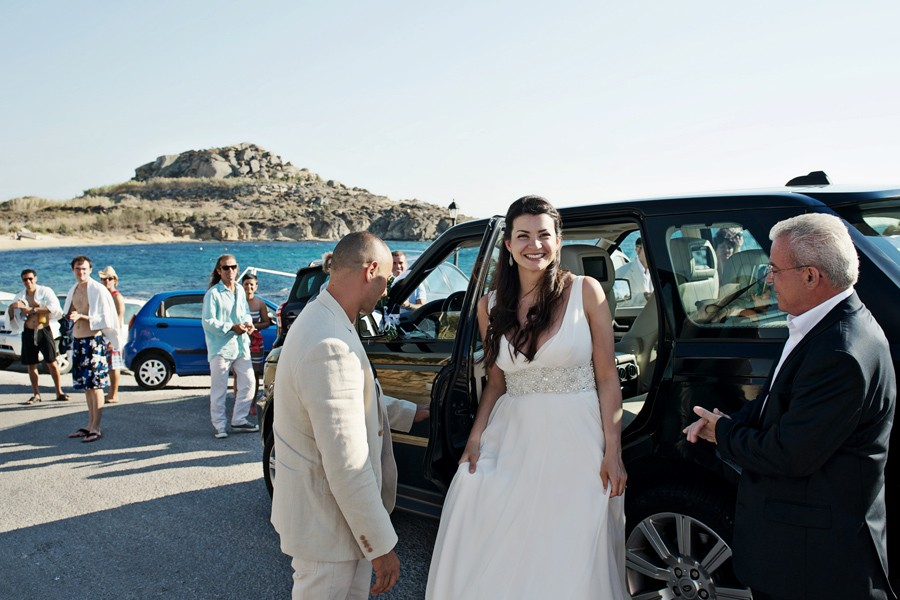 bride arrives at the church in mykonos wedding