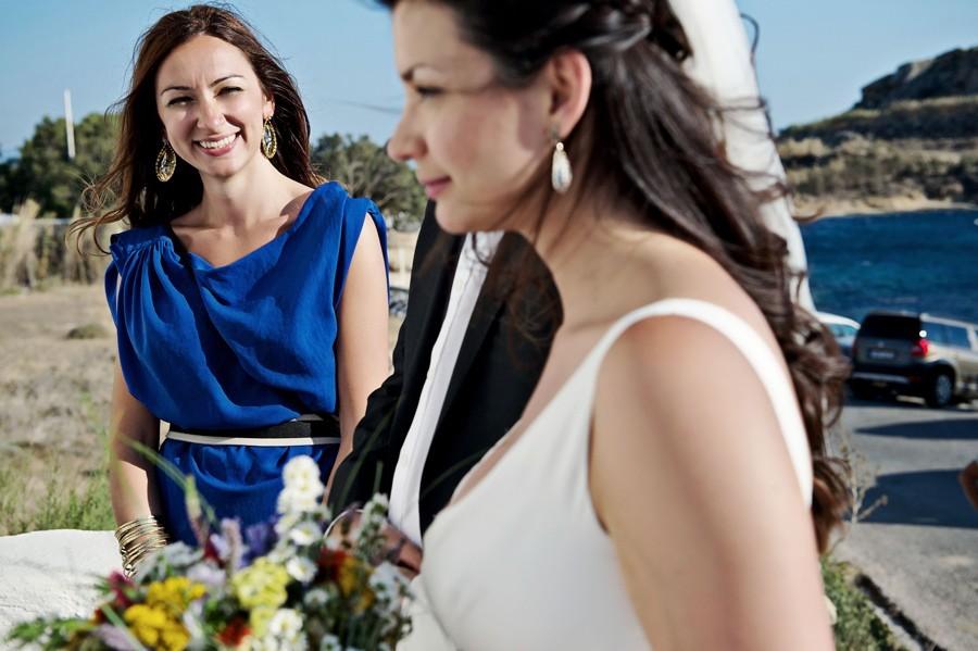 bridesmaid looking the bride in mykonos wedding