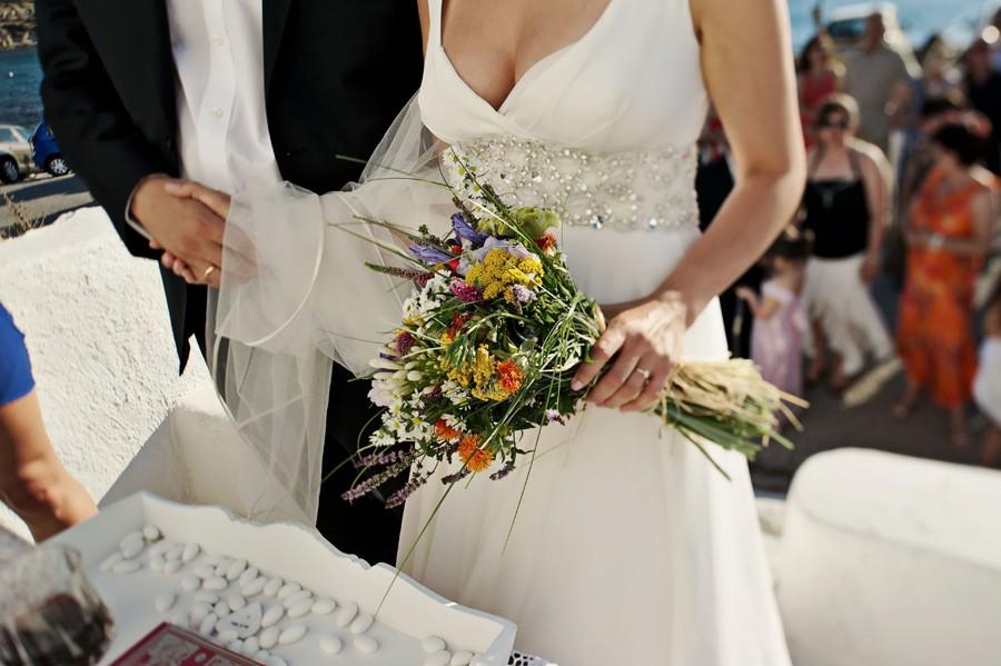 bride holding the bouquet in mykonos wedding