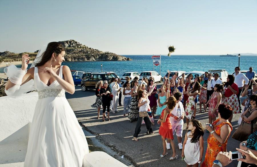 bride throws the bouquet in mykonos wedding
