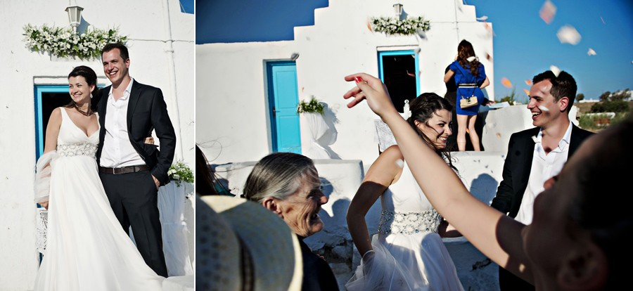 guest throw flower petals to the couple in mykonos wedding