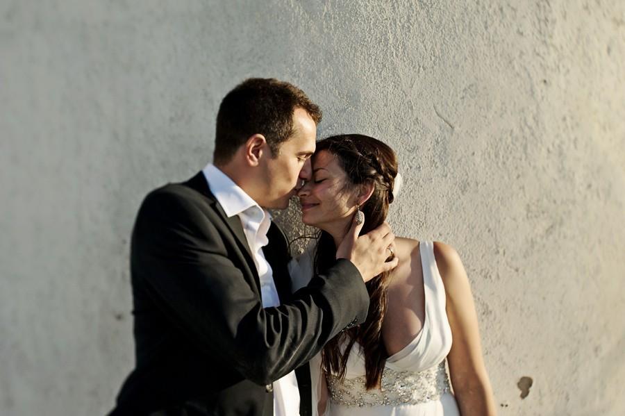 groom kiss the bride in mykonos wedding