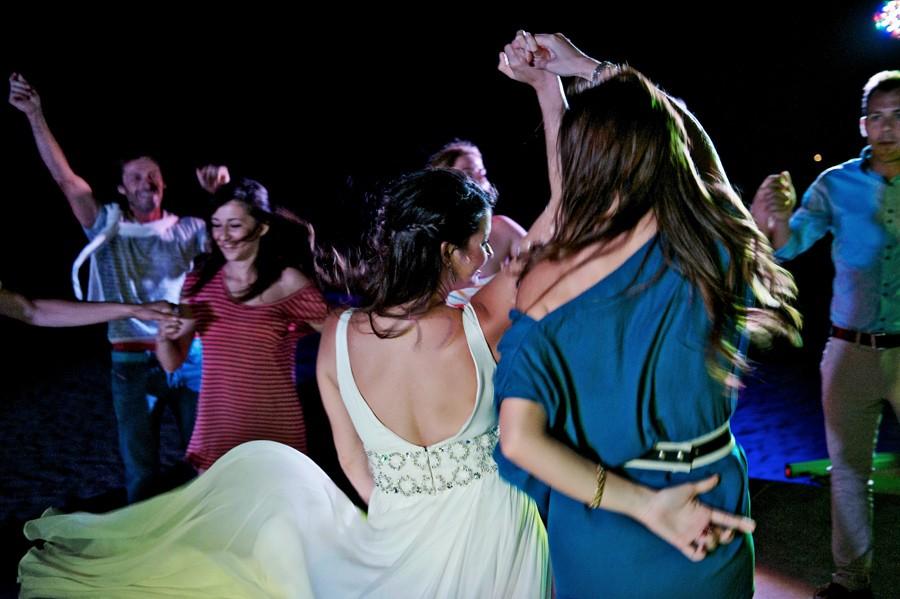 bride dancing with her bridesmaid in mykonos wedding party
