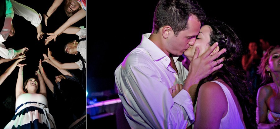 bride and groom first kiss in mykonos wedding party