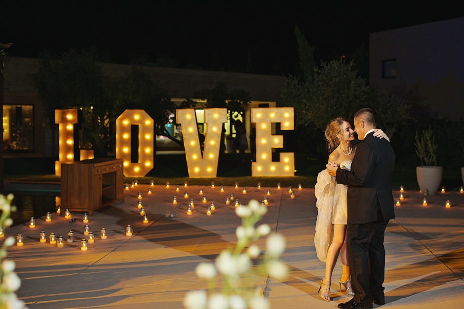 couple exchanges vows in costa navarino wedding