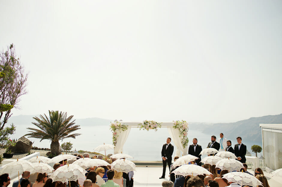 groom waiting for the bride at wedding ceremony in le ciel santorini