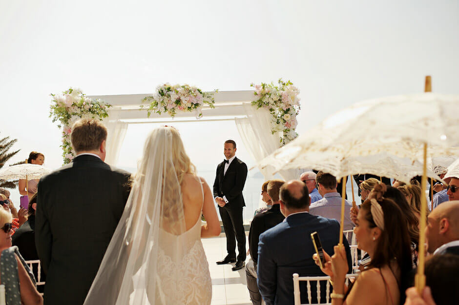 bride walking the aisle in le ciel santorini