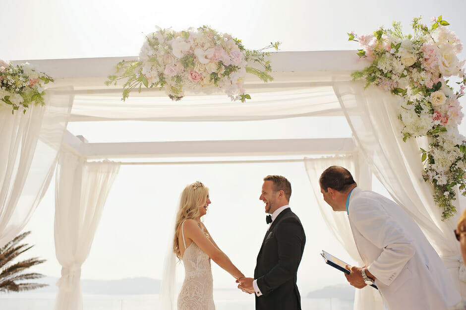 you may kiss the bride moment in le ciel santorini