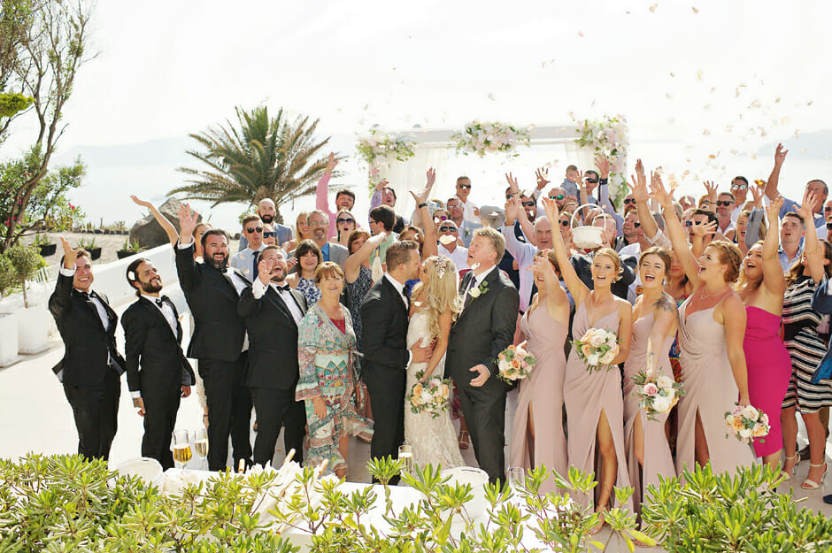 the most beautiful wedding group photo in le ciel santorini