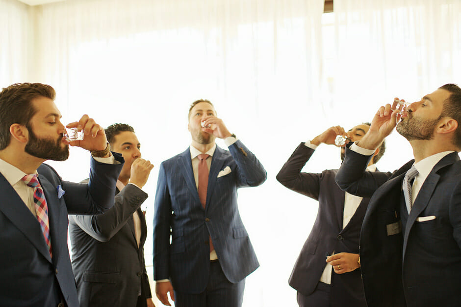 groom with groomsmen drinking before the wedding in athens riviera