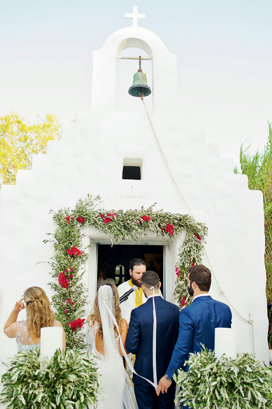 wedding ceremony in white chapel inside island art and taste