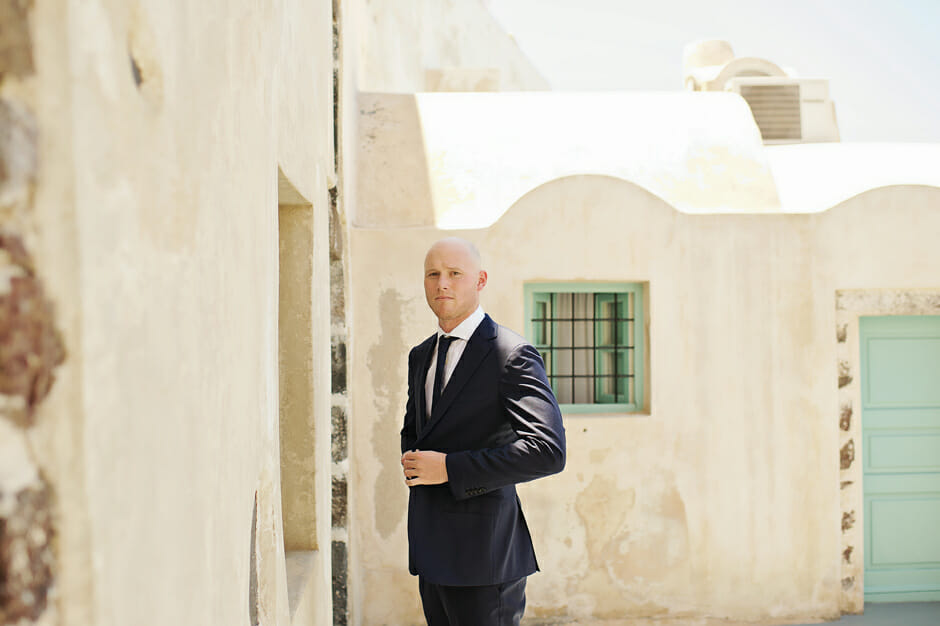 groom portrait during his elopement in santorini
