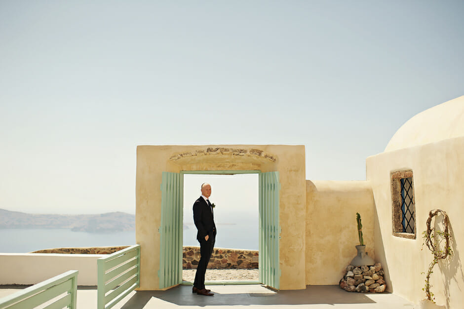 groom waiting the bride for the elopement in santorini