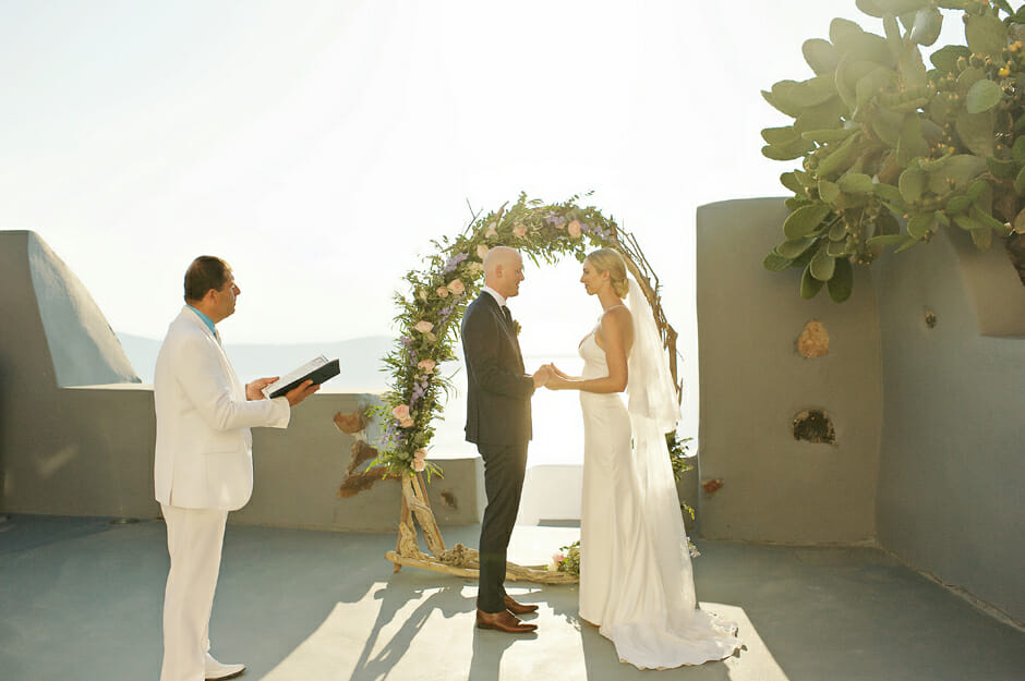 celebrant starts the elopement ceremony in santorini