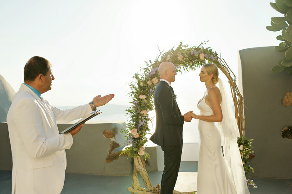 you may kiss the bride moment in santorini elopement