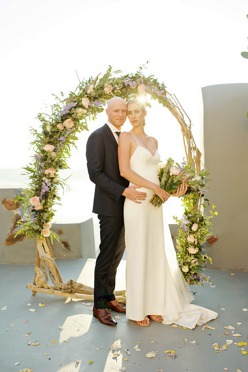 bride and groom in front of the elopement arch