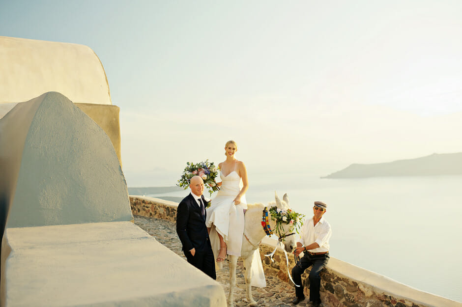 bride riding donkey in santorini