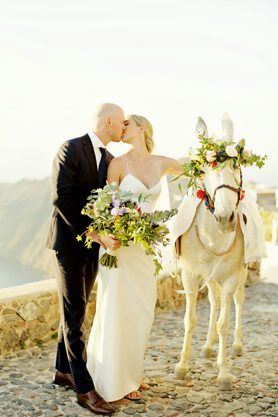 bride groom and white horse in santorini