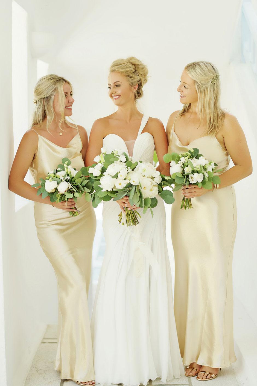 bride and bridesmaids holding bouquet mykonos wedding