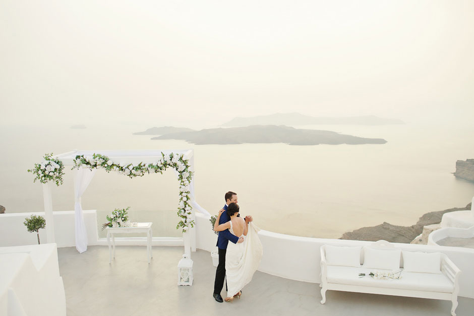 bride-and-groom-first-dance-on-their-elopement-in-Santa-Irene-in-Santorini