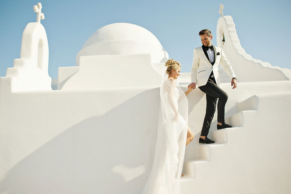 bride and groom in front of white chapel in mykonos wedding