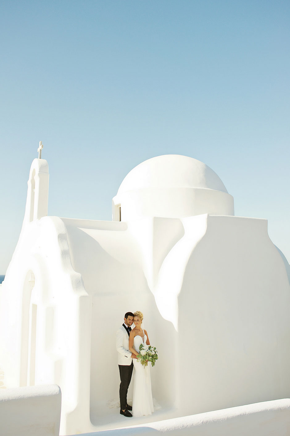 bride and groom portrait at mykonos white-chapel
