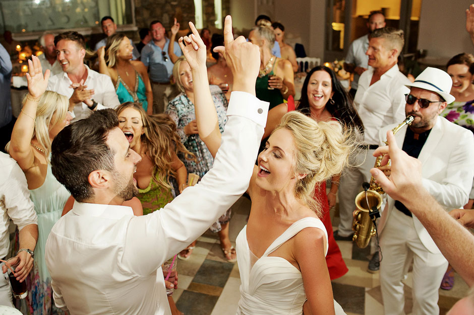 bride and groom singing in mykonos wedding party