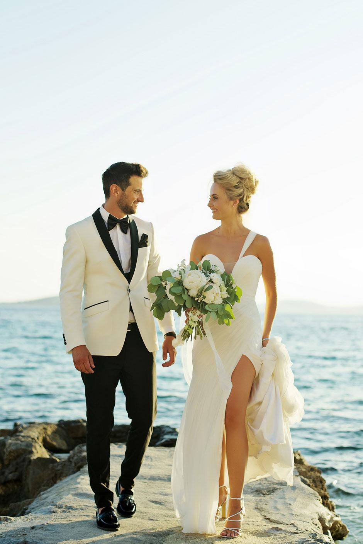 bride and groom walking at the beach in mykonos wedding