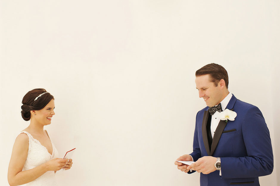 bride-and-groom-reading-voes-on-their-elopement-in-santa-irene