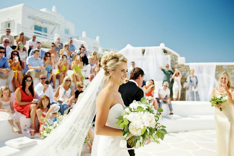 bride arrive at the wedding ceremony in mykonos