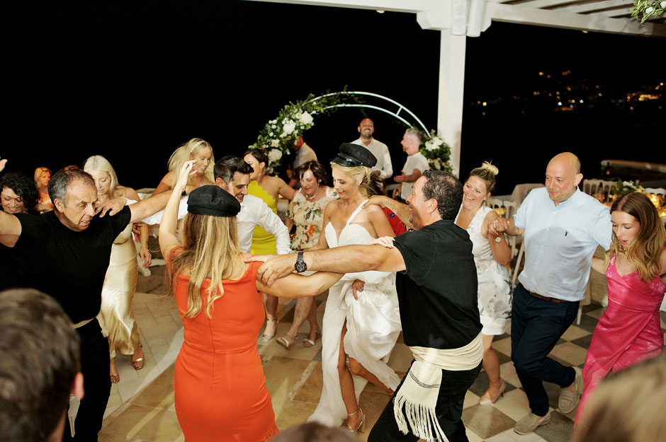bride dancing with greek dancers in mykonos