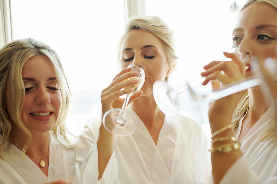 bride drinking champagne in saint John mykonos