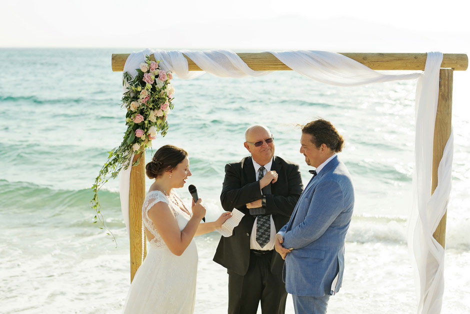bride reading vows on a beach
