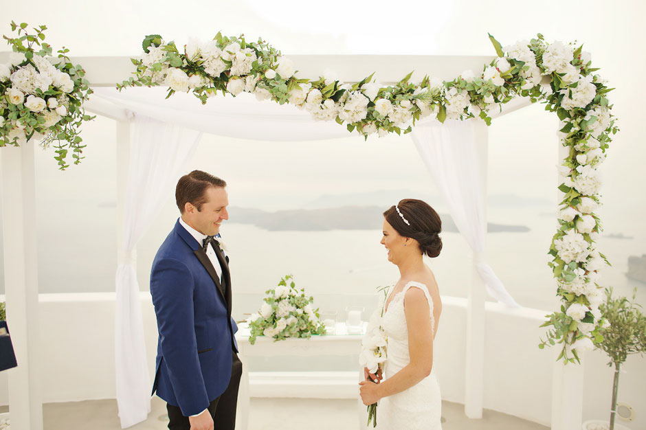 bride-sees-the-groom-for-the-first-time-on-the-elopement-ceremony-in-santa-irini-in-santorini