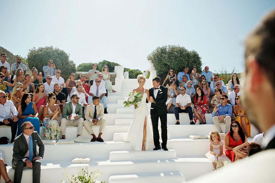 bride walking down the aisle in mykonos star hotel