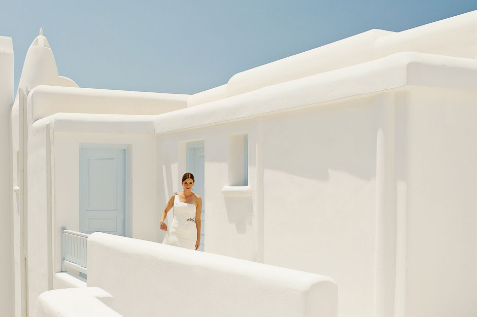 bride walking for the first look in mykonos elopement