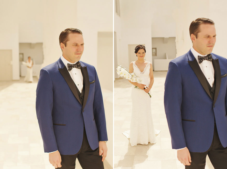 bride-walking-to-the-groom-for-their-first-look-before-the-elopement-ceremony-in-santorini-santa-irene-chapel