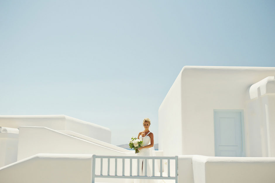 bride holding bouquet in st John mykonos wedding