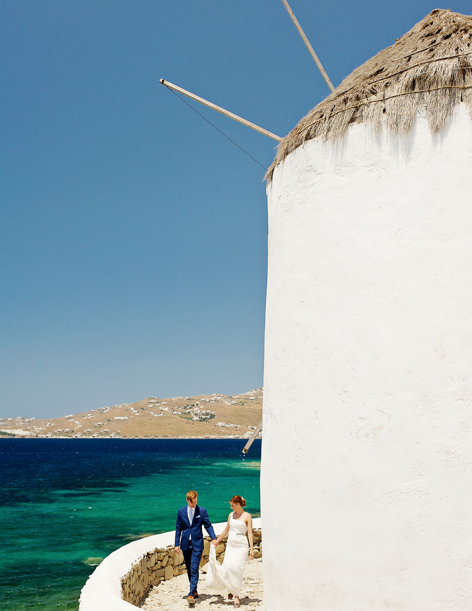 elopement couple walking at mykonos windmills