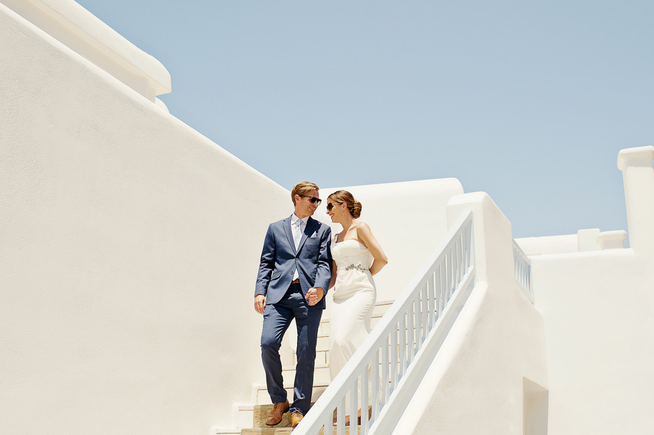 elopement couple walking down the stairs in myonos saint john hotel