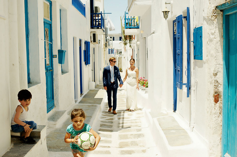elopement couple walking in mykonos town