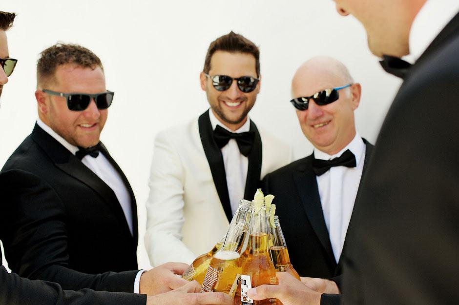 groom drinking beer with groomsmen in korfos hotel mykonos