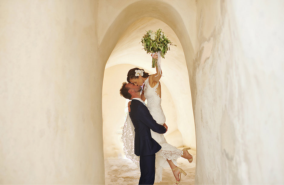 groom lifting bride in santorini